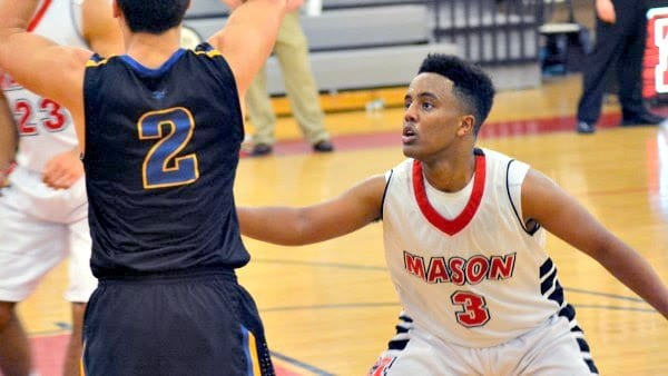 GEORGE MASON JUNIOR Biruk Teshome locks in on defense against Central on Tuesday. Teshome led the Mustangs with 20 points in the team's 63-45 win. (Photo: Carol Sly)