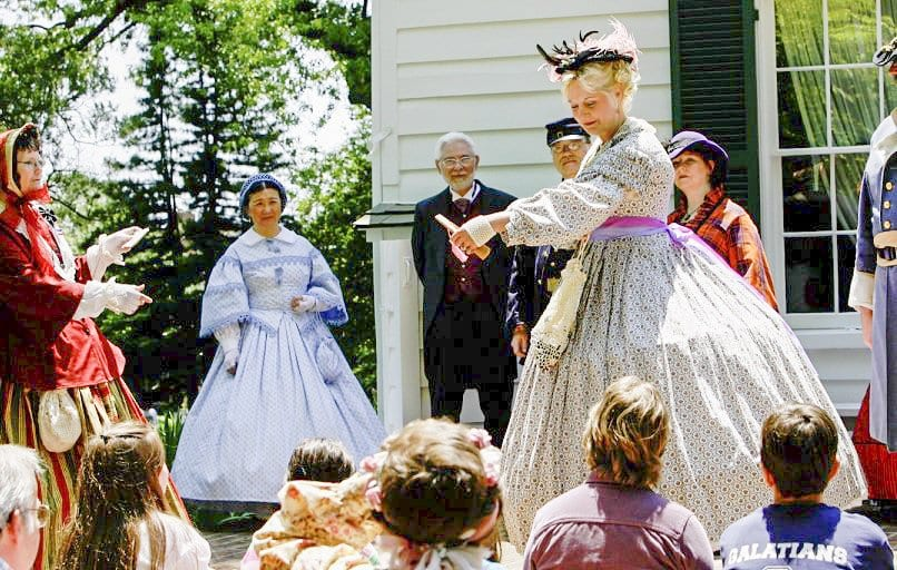 A COSTUMED DOCENT presents for a crowd during a recent Civil War Day in the City of Falls Church. The City decided to put on Living History Saturday events in August in order to make up for Civil War Day 2016, which had to be modified because of the rain. (Courtesy Photo)