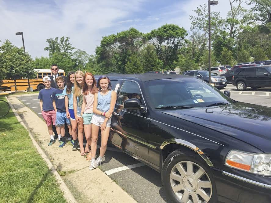 This group of students rode home in style on Friday, May 20 after one of the students earned the trip due to completing their algebra homework in the third quarter. (Photo: Courtesy of Marybeth Connelly/FCCPS)