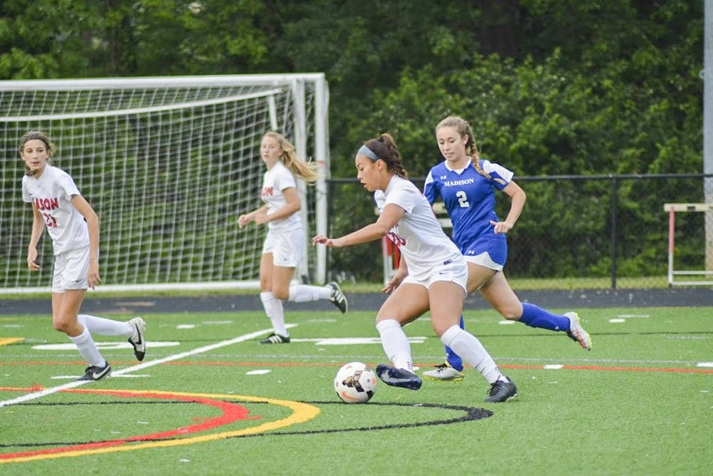 MASON JUNIOR REBECCA CROUCH dribbles through the Madison County High School defense during the Mustangs' recent win over the Mountaineers. Crouch scored to Mustangs' first goal against Rappahannock County High School on Tuesday, May 10. (Photo: Carol Sly)