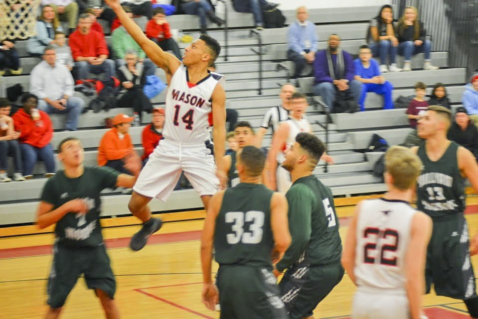 MASON SENIOR ROBERT TARTT goes up for a layup during the Mustangs' 62-41 win over William Monroe High School on Friday, Jan. 29. (Photo: Carol Sly)