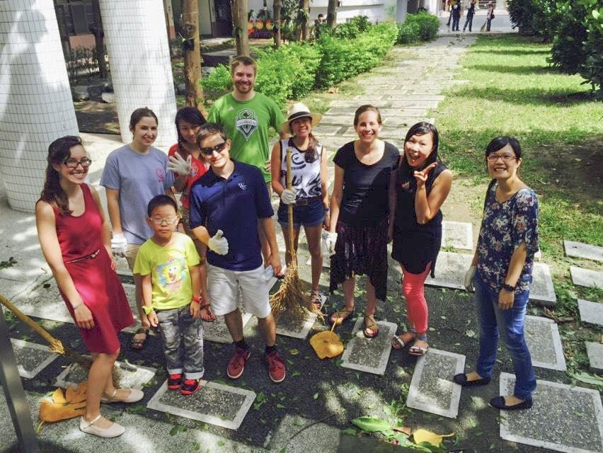 Falls Church resident Matthew N. Baker (front, third from left, wearing sunglasses) with other English teaching assistants at a typhoon cleanup in Taichung, Taiwan. (Courtesy Photo)