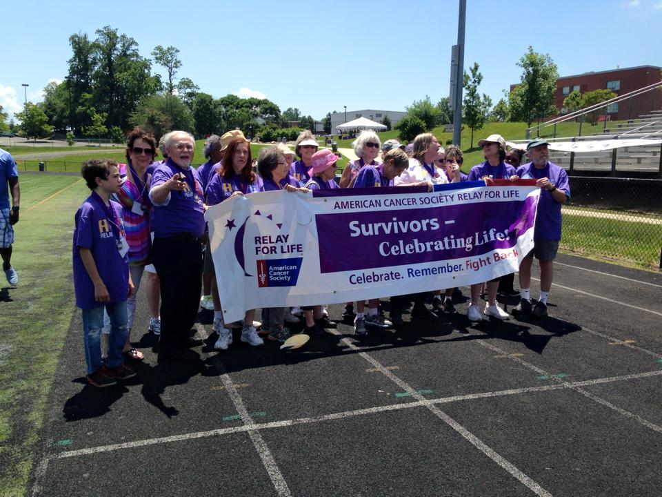 Cancer survivors (including Falls Church City councilman Phil Duncan) from Arlington, Falls Church and Vienna gather for the first lap around the track at George Mason High School during the American Cancer Society's Falls Church-Vienna Relay for Life on Saturday. Over 500 people from the area participated in the event. (Photo: Courtesy of Katie Sue Van Valkenburg)