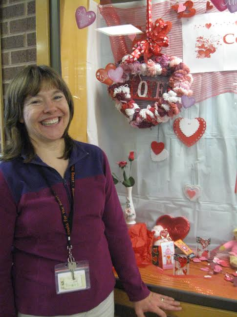Bonnie Borchert, Tysons-Pimmit Regional Library's youth services manager stands next to the library's valentine's  display. (Photo: Patricia Leslie/News-Press)