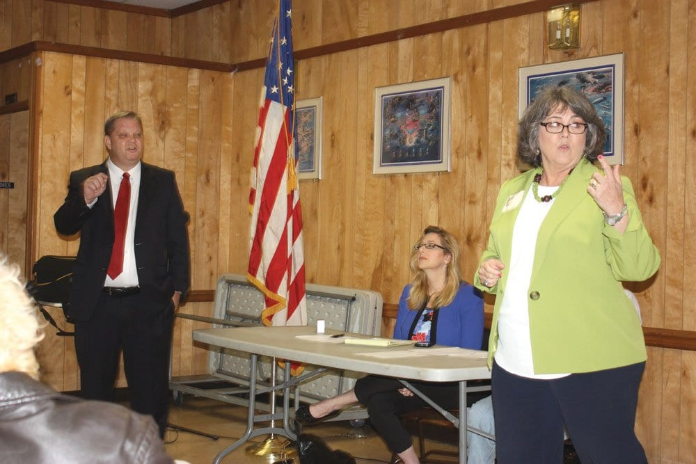 FALLS CHURCH CITY TREASURER Jody Acosta (right) makes a point at a recent community forum at the American Legion hall, as her opponent, independent Chris Johnson (left) looks on. Acosta, endorsed by the F.C. City Democratic Committee, and Johnson are seeking election to fill the unexpired term of retired City treasurer Cathy Kaye. (Photo: News-Press)