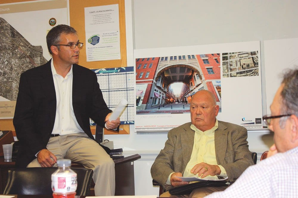 """SPECTRUM DEVELOPMENT'S Peter Batten (left) and Dick Buskell (seated) presented their new """"Mason Row"""" plan for W. Broad and N. West Street to the F.C. City Council's Economic Development Committee Monday night. (Photo: News-Press)"""