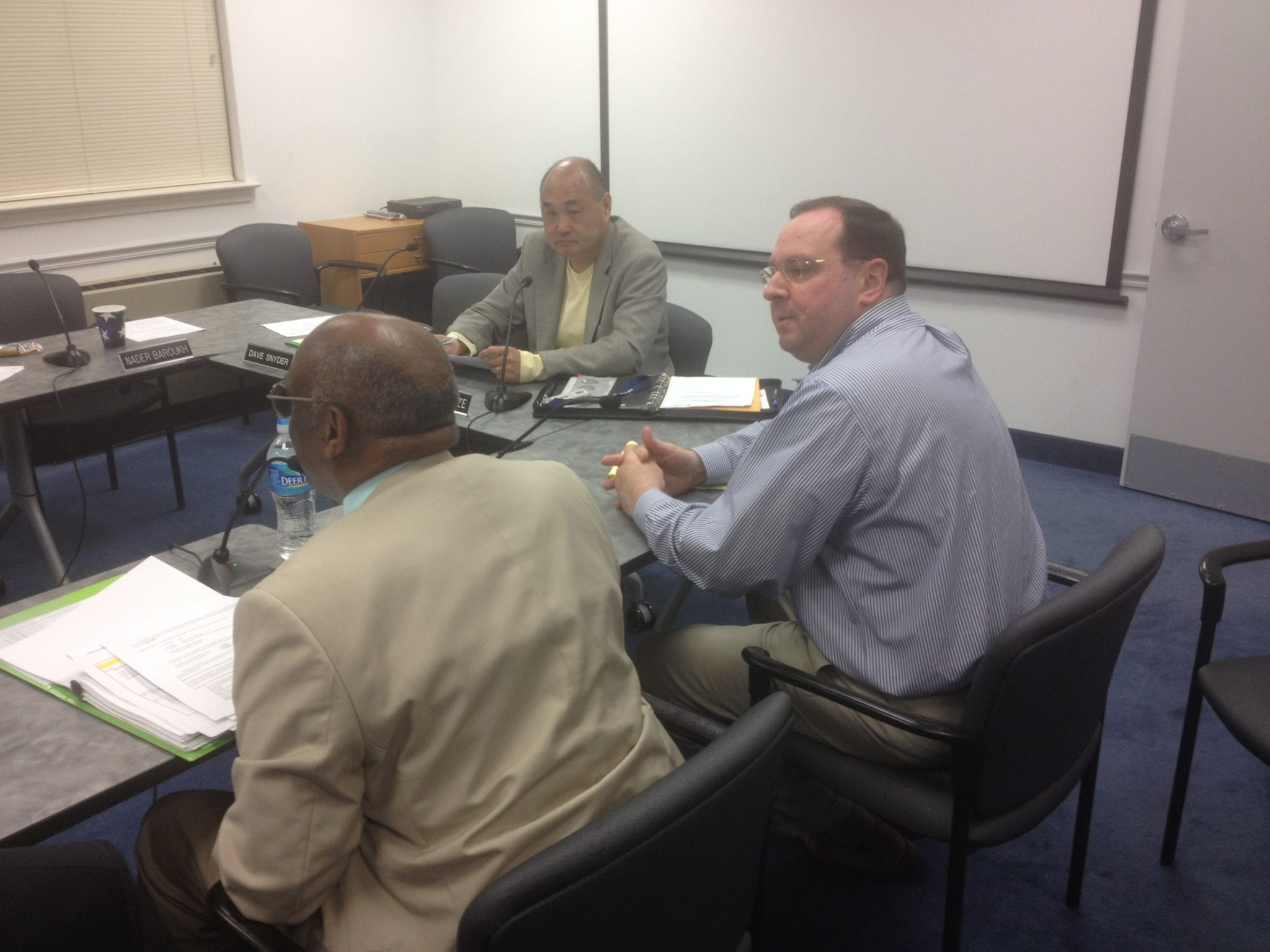 CHIEF FINANCIAL OFFICERS for the City of Falls Church, Richard LaCondre (left) and Hunter Kimble (right) took on the City Council's concerns for finding ways to lower the proposed tax rate increase tonight. (Photo: News-Press)