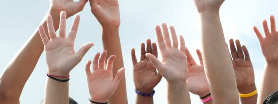 Photo of children's hands raised