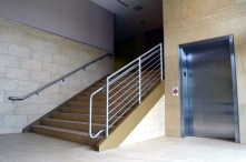 New stairwell and elevator access to the first floor from ground level