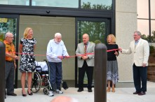 Former Fond du Lac Police Chief and County Board Supervisor Mel Heller cuts the ribbon, marking the official opening of the north entrance