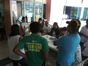 Evelyn Castillo (far left) conducting a meeting with local fisherfolk in Giporlos, Samar