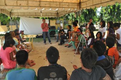 James Castillo (standing center) leads youth in a film making workshop