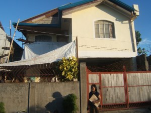 Bayanihan Foundation's Philippine LIaison, Evelyn Castillo home with a newly rebuilt roof after Typhoon Haiyan