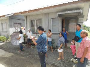 Dale Asis (center) and Evelyn Castillo (next) surveys the area for the additional 40 homes in Dingle, Iloilo