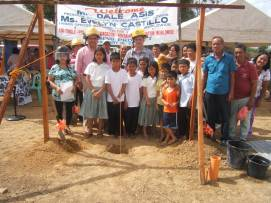 Foregound: Children living in Dingle, Iloilo that will potentially live in the 40 new homes. Background (left to right): Evelyn Castillo, Dale Asis, Dr. Rufino Palabrica and Mr. Jessie Alecto