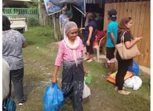 Filipino Muslim woman receiving food packages during Ramadan