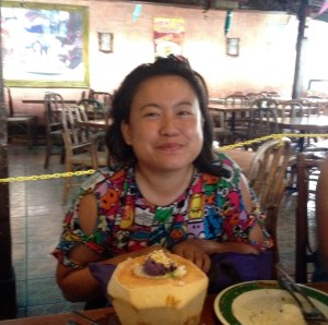 Jeselle Santiago enjoying her first halo halo (ice cream with tropical fruits) served in a fresh coconut shell