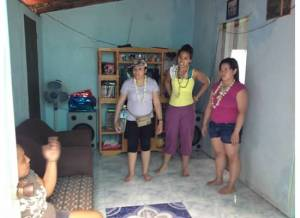 (left to right): Jane Baron, Crystle Dino and Jeselle Santiago prepares for a home visit in Liloan, Cebu