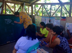 Bob Newlon (middle wearing yellow shirt) explains the BOB Toilet Without Water to Community Leaders of Village Salvacion, Giporlos, Samar