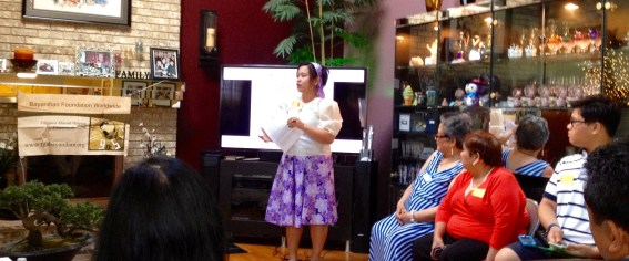 Jeselle Santiago announces the launch of the Community Power Giving Circle with Shirley Pintado (second from right) and Alicia Santiago (far right) looking on (June 2016)