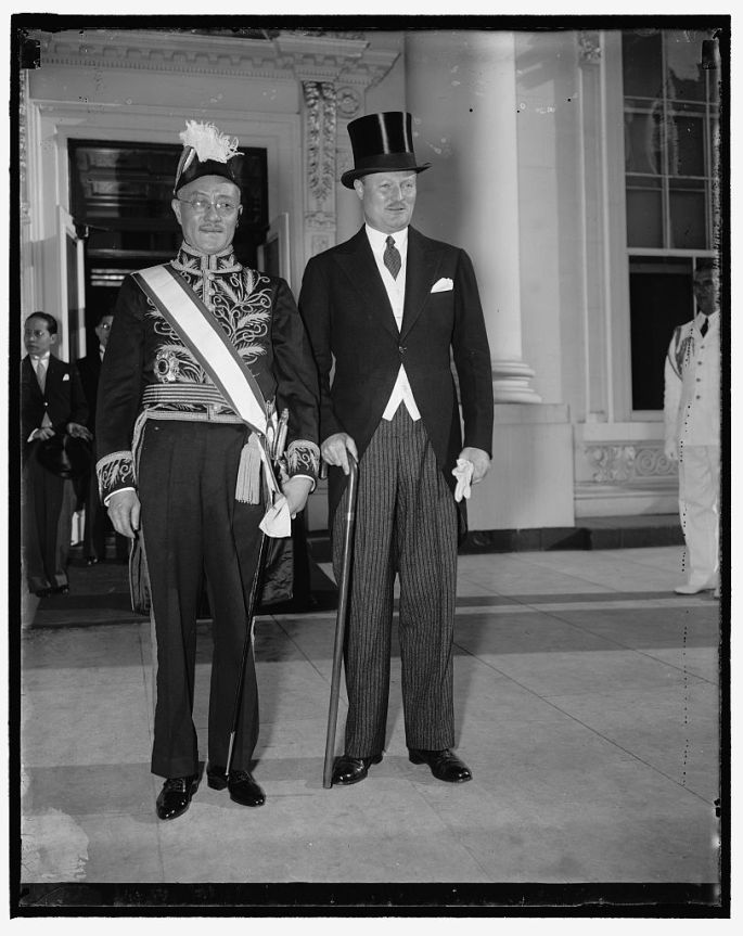 Presents credentials. Washington, D.C. June 8. Dr. Chenting T. Wang, new ambassador from China to the United States, leaving the White House today after presenting his to President Roosevelt. Richard South gate of the State Department, accompanied the new ambassador. 6/8/37