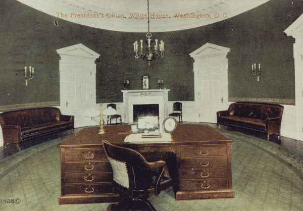 Hand tinted image of a desk and chair in an oval room