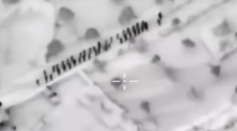 Insane drone strike on ISIS. Photo taken from the video.