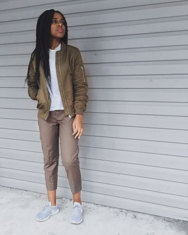 white t-shirt, olive green bomber jacket, olive green dress pants, white flower necklace, grey nike sneakers