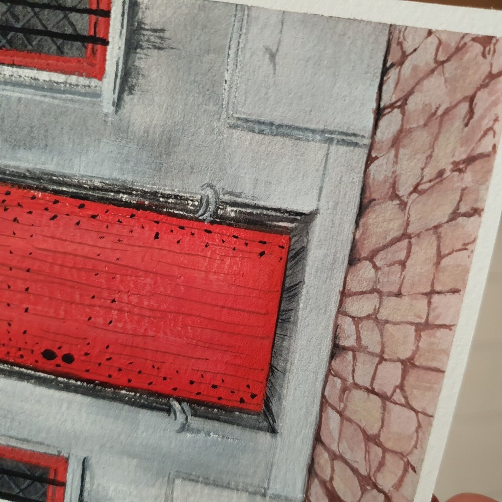 Bright red door on a medieval building painted with gouache
