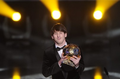 Argentina's Lionel Messi is awarded the