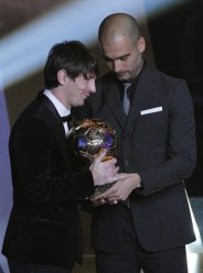 Messi of Argentina FIFA World Player 2010 is presented trophy by soccer coach Guardiola during FIFA Ballon d'Or 2010 soccer awards ceremony in Zurich