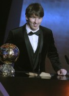 Messi of Argentina FIFA World Player 2010 stands next to his trophy during the FIFA Ballon d'Or 2010 soccer awards ceremony in Zurich