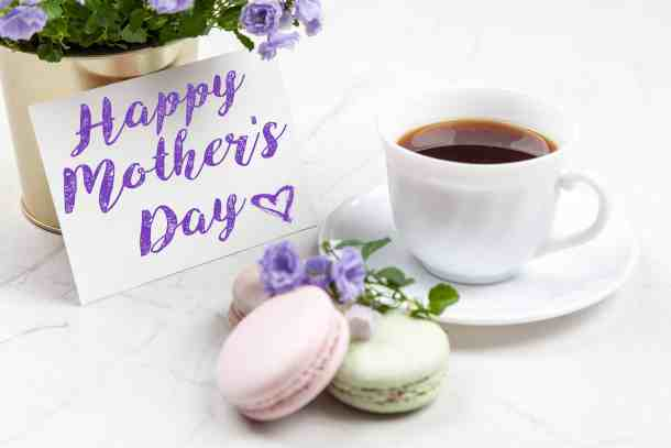 coffee, macarons, flowers and a card saying happy mothers day