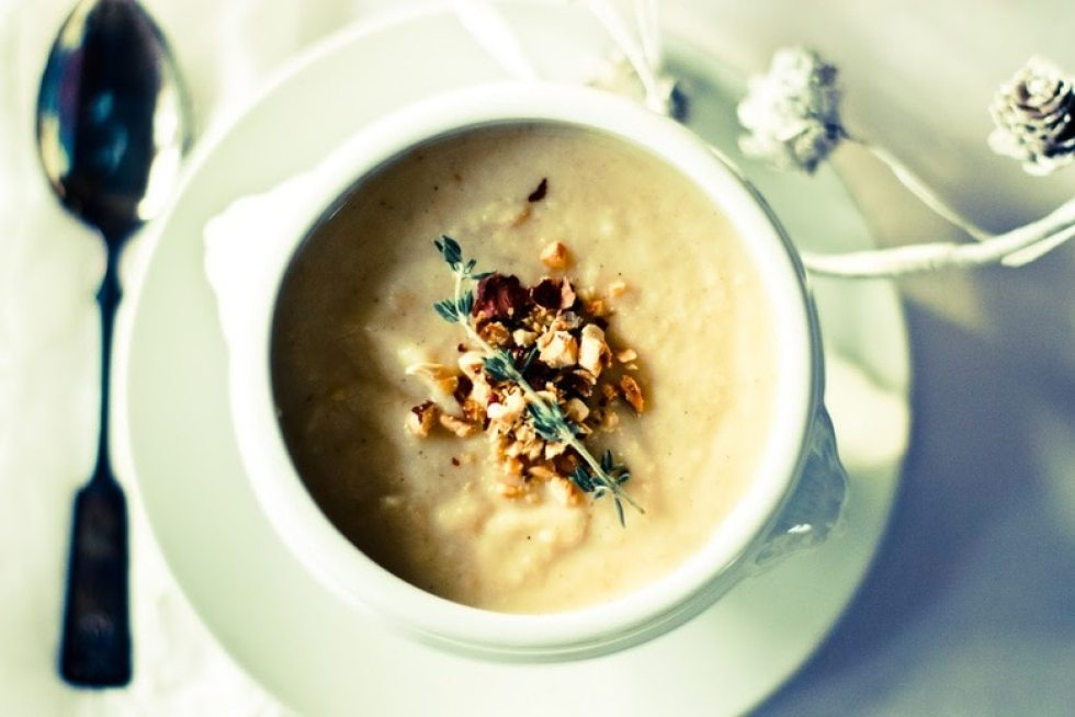 A wintery hearty recipe for Roasted Parsnip Apple Soup with toasted Hazelnuts- elegant enough for the holidays or a casual weeknight meal. Delicious, easy. | www.feastingathome.com