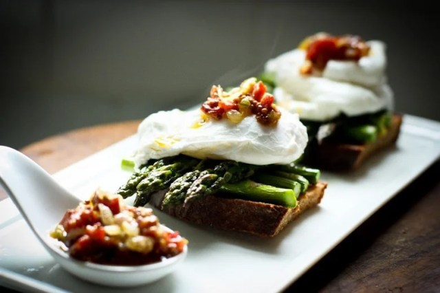 A simple breakfast- Roasted asparagus on toast with poached eggs and a warm bacon mustard vinaigrette. Or make this for dinner! | www.feastingathome.com
