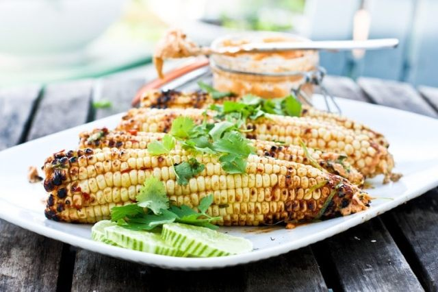 Grilled Corn with Chipotle Butter, cilantro and lime. | www.feastingathome.com