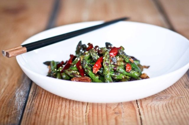 Easy, flavorful Wok-Seared Asparagus with Chili, Garlic, Black bean Sauce are made Shanghai Style,quick and easy yet full of flavor! | www.feastingathome.com