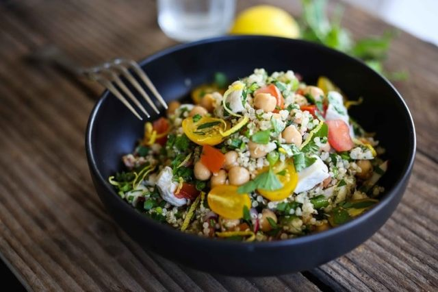 A delicious recipe for Quinoa Salad with summer tomatoes, Chicken (or Chickpea), mint parsley and a zesty lemony dressing.