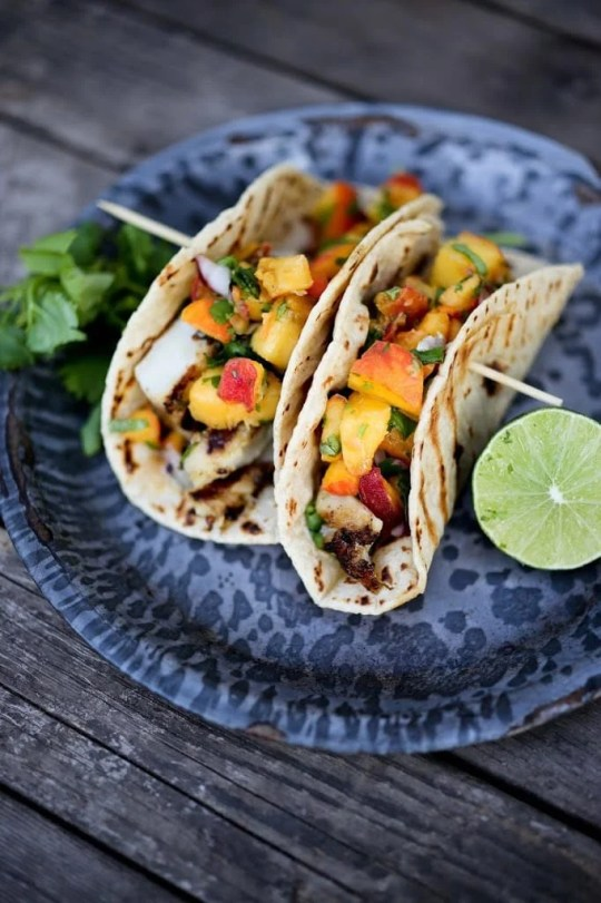 Grilled Chipotle Fish Tacos with fresh Peach Habanero Salsa. Delicious summertime flavor! | www.feastingathome.com