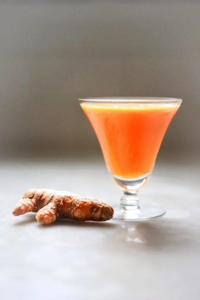 Turmeric Tonic - A healthy juice made with healing turmeric root, beets, apple, ginger and carrots to help heal the body, fightinflammation, sooth and energize.| www.feastingathome.com