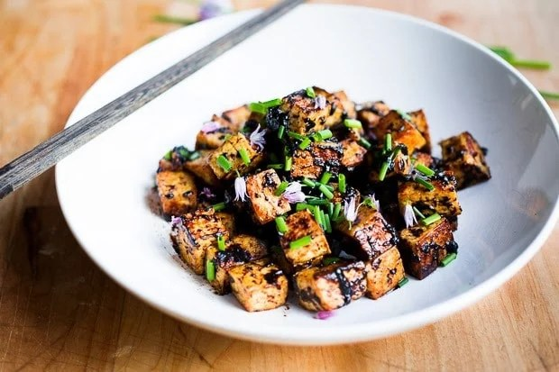 Black Garlic Tofu with chives... a flavorful way to prepare tofu! | www.feastingathome.com