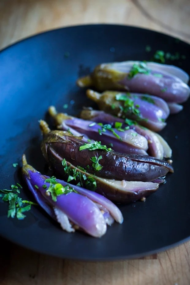 Moroccan pickled eggplant with garlic, coriander and cilantro. Drizzled with olive oil they make the perfect addition to any meal. | www.feastingathome.com.com
