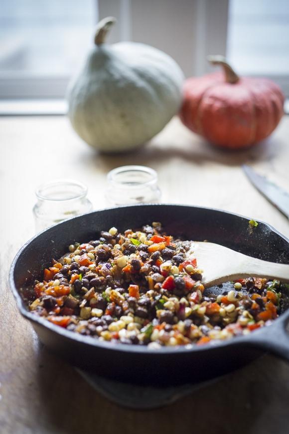 Enchilada Stuffed Spaghetti Squash with black beans, cilantro, corn and bell pepper --keep it vegan or add cheese | www.feastingathome.com