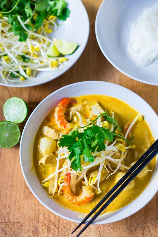 Malaysian Laksa Soup w/ Coconut, Curry, Chicken and Shrimp over rice noodles| www.feastingathome.com