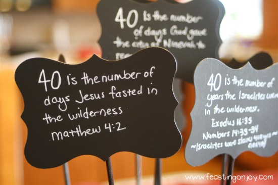 Close Up of Fortieth Birthday Party Bible Verse Signs