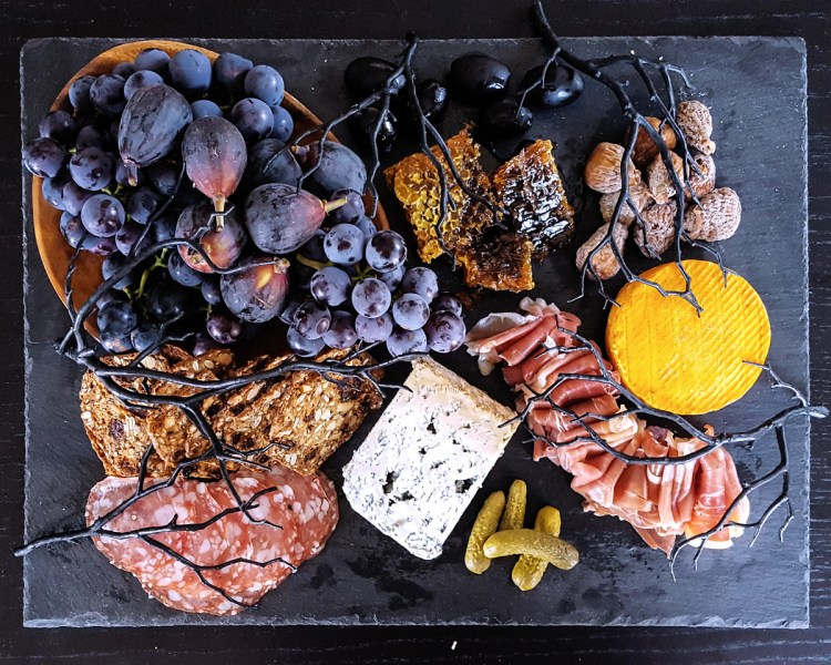 Looking for a touch of the dramatic this October? Use these tips and tricks to put together a deceptively creepy Halloween Cheese Board, and impress your guests with a macabre twist on a crowd-pleasing classic. | FeastInThyme.com