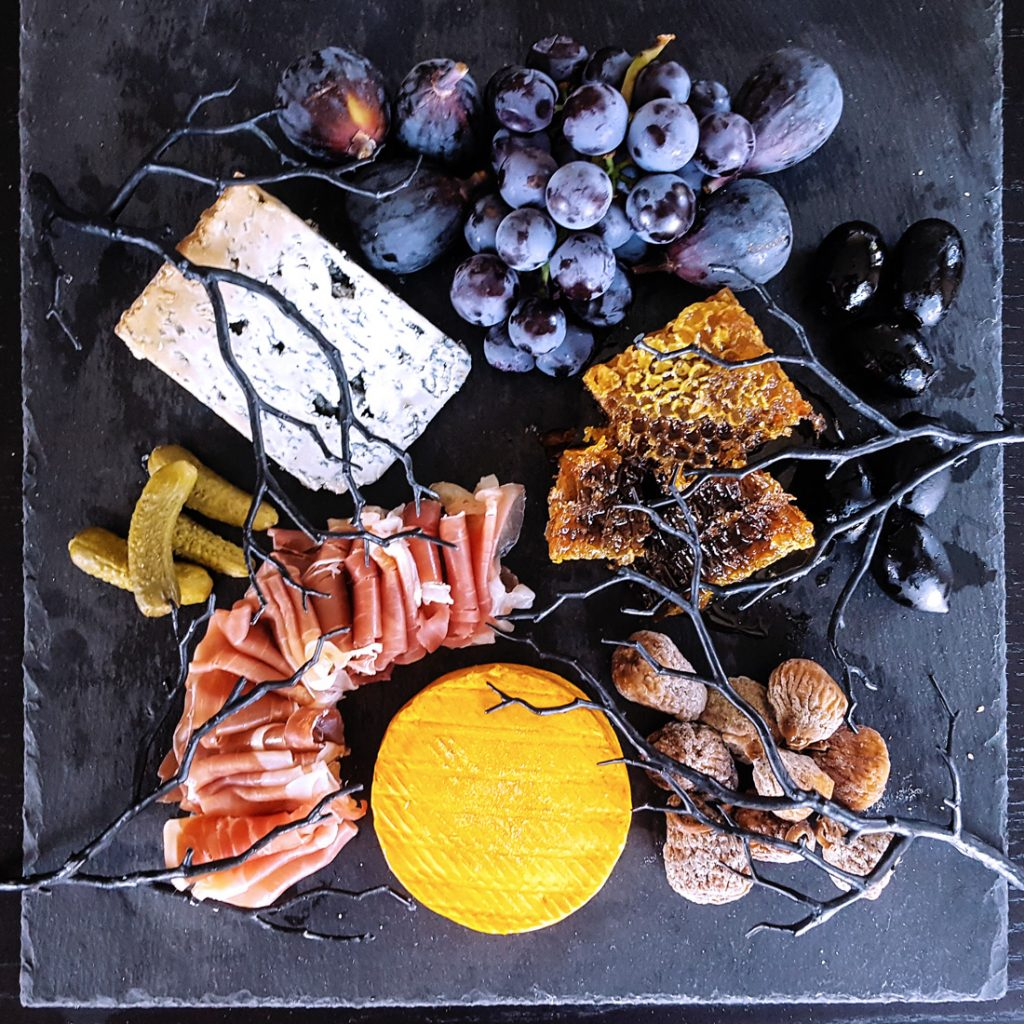 Looking for a touch of the dramatic this October? Use these tips and tricks to put together a deceptively creepy Halloween Cheese Board, and impress your guests with a macabre twist on a crowd-pleasing classic.   FeastInThyme.com