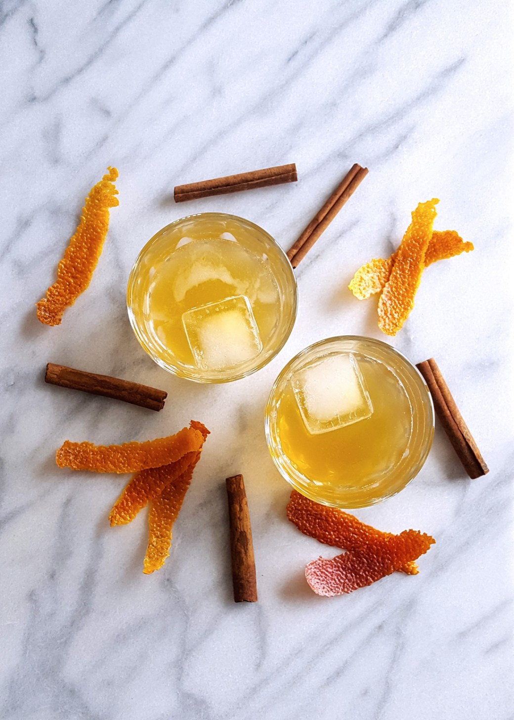 With a rich cinnamon syrup & the scent of blood orange, this Cinnamon Spiced Old Fashioned Cocktail will keep you (and your company) cozy and warm on even the chilliest days. | FeastInThyme.com