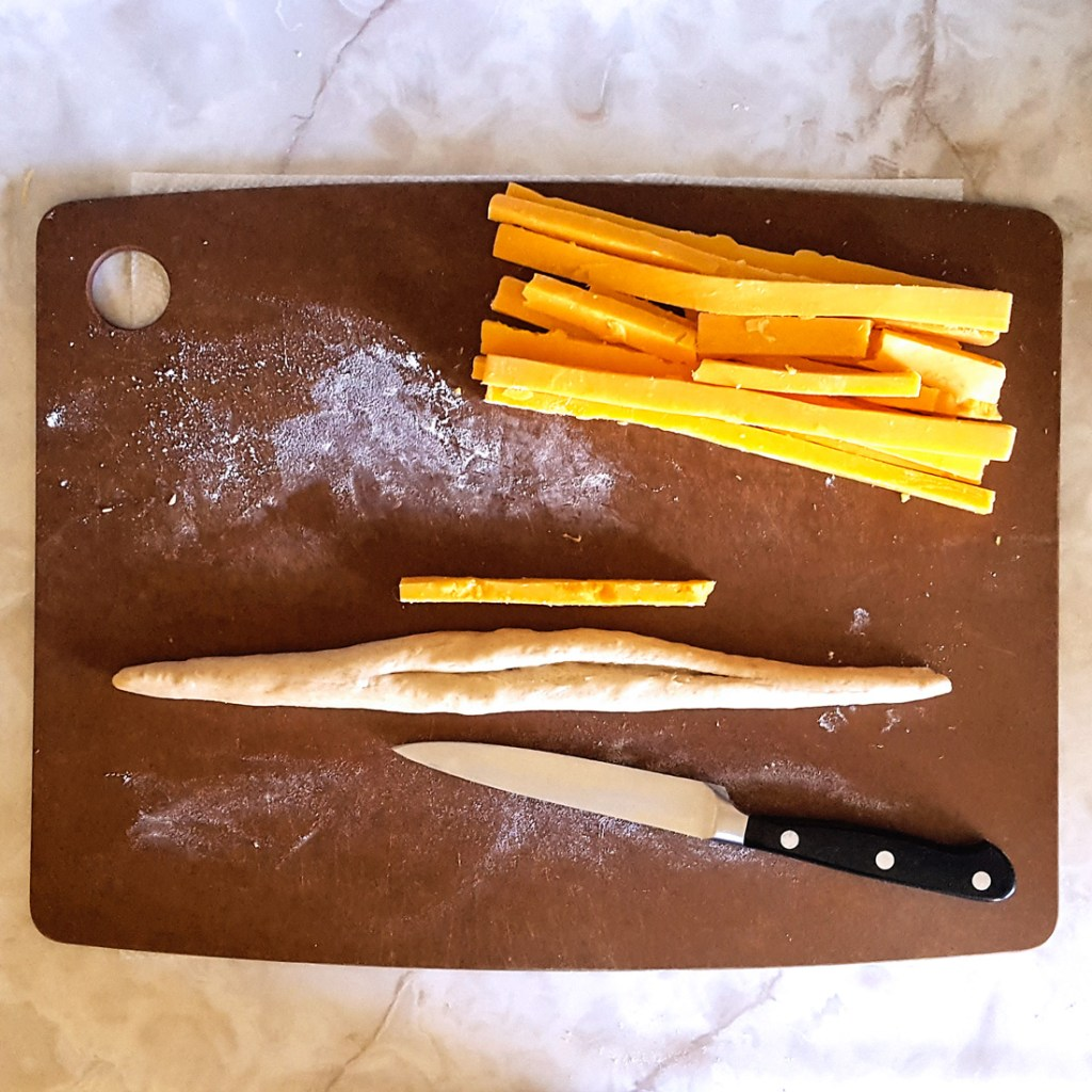 Prepping the dough for Cheesy Pumpkin Beer Pretzel Twists | FeastInThyme.com