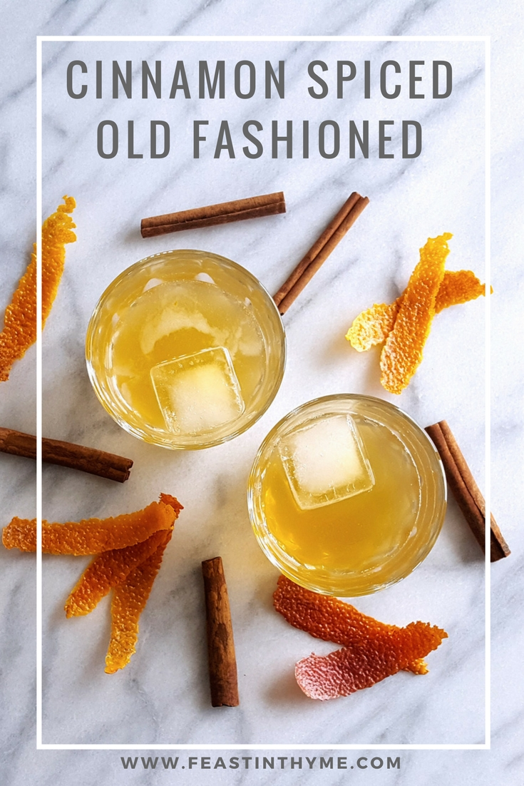 With bourbon, a rich cinnamon syrup & the scent of blood orange, this Cinnamon Spiced Old Fashioned Cocktail will keep you (and your company) cozy on even the chilliest days. | FeastInThyme.com